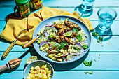 Spiced caribbean chicken fillets with coconut, lime and coriander couscous and pinapple chilli salsa