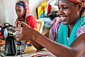 Women sewing cloths, Lamu, Kenya
