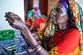 Woman sewing cloths, Lamu, Kenya