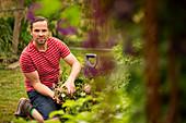 Confident man harvesting vegetables in garden