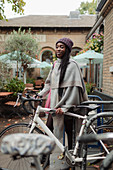Young woman in pashmina with bicycle