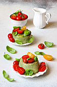 Sheep ricotta flans with basil and tomatoes