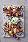 Potato and vegetable kebabs with a spring onion dip