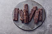 Vegan cocoa and nut bars with dates and flax seeds