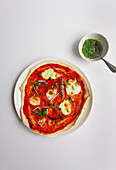 Pizza with anchovies, capers and lemon oil