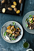 Fried porccini mushrooms with baked potatoes and Parmesan cream