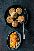 Freekeh and bacon cakes with glazed herb carrots