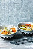 Colourful vegetables and tagliatelle with a creamy cheese sauce