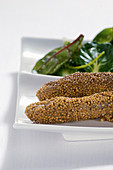 Lamb fillets baked in mustard seeds with salad