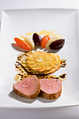 Pork fillet with beer and caraway sauce and potato rosettes