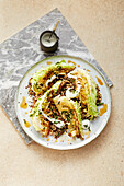 Pointed cabbage with quinoa and feta cream