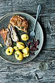 Allgäu country schnitzel with mini potatoes and lingon berries