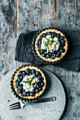 Blueberry tartlets with creamy crunch and macadamia nuts