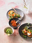 Blinis with salmon caviar and avocado
