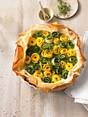 Spring tart with a duo of courgette roses