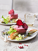 Beetroot mousse with beetroot crispy and a salad garnish