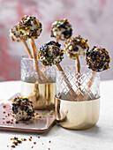 Cream cheese 'pops' made from soft sour cherries, pumpernickel and macadamia nuts