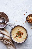 Creamy corn soup with roasted onion and rosemary