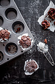 Chocolate muffins with raspberries inside