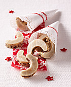 Christmas rum biscuits with sugar icing in cone bags