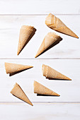 Empty ice cream cones on a white surface