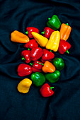 Red, green and yellow mini peppers