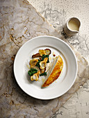 Roast chicken with brown bread sauce and Jerusalem artichokes