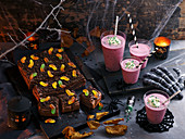 Halloween entertaining table set with whitches brew and dirt brownie
