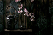 Japanese teapot with blooming cherry branches