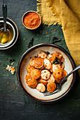 Breakfast Mini Idli served with ghee and curry powder