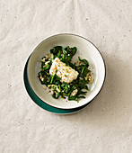 Steamed cod with spinach and pine nuts