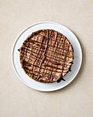 Almond and white chocolate gateau with bitter chocolate glaze