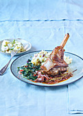 Baked shanks of lamb with spinach and mashed potatoes