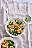 Creamy spinach and parsley root stew with sourdough and feta dumplings