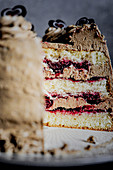 Mocha cake with sour cherries and red wine, cut