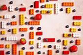Blueberries, strawberries and colourful Lego bricks