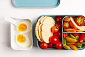 Snack box 'To Go' with fruit, vegetables and boiled eggs