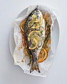 Baked sea bream with lime, lemon and grapefruit