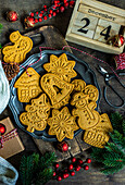 Vintage plate full of gingerbread cookies on wooden table