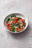 Buckwheat with spinach, beans and tomatoes