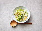 Chinese cabbage salad with walnuts, egg and apple dressing