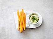 Carrot sticks with avocado dip