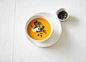 Pumpkin soup with pumpkin seeds and sour cream