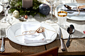 Place setting with a white napkin on Christmas table