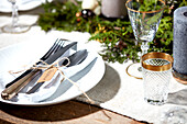 Place setting with white napkin on Christmas table
