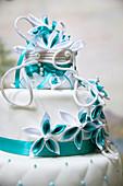 White fondant cake with turquoise decoration