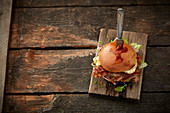 Burger with wild boar patty, halloumi and bacon