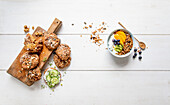 Carrot and wheat biscuits, with crunchy muesli in yogurt
