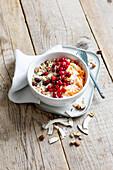 Bircher muesli with carrots, soy yogurt, and cranberries