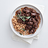 Peposo beef with Chianti and white beans